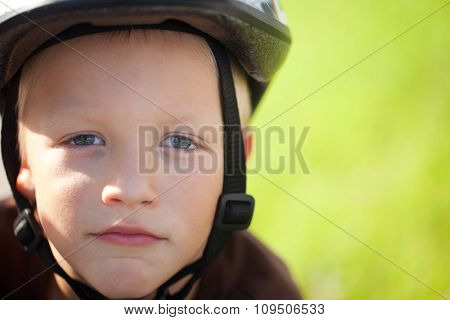Portrait Of A Positive Little Boy On A Bicycle Outdoor