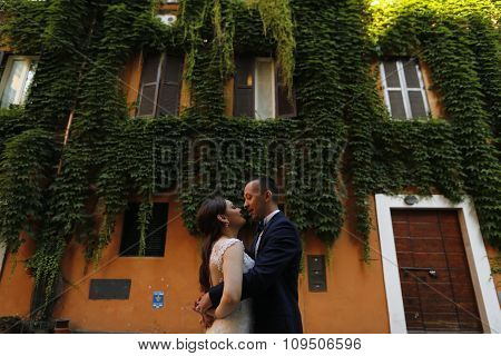 Beautiful Bridal Couple Embracing In Old City