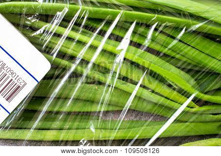 Packaging Of Fresh Green Onions With A Price Tag