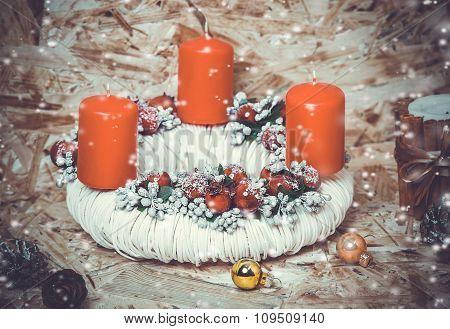 New year decorations. Candlestick, cinnamon, snow.  toning photo.