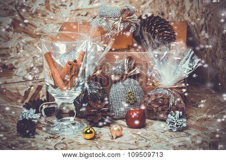 New year decorations. Honey, coffee, cones, cinnamon, box, snow.  toning photo.
