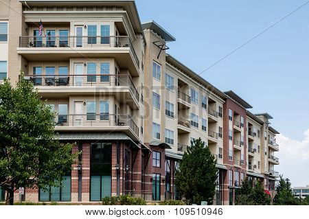 Brick And Stucco Condos With Balconies