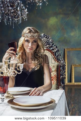 young blond woman wearing crown in fairy luxury interior with empty antique frames