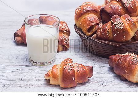Bagels With A Glass Of Milk On A Blurred Background Basket With
