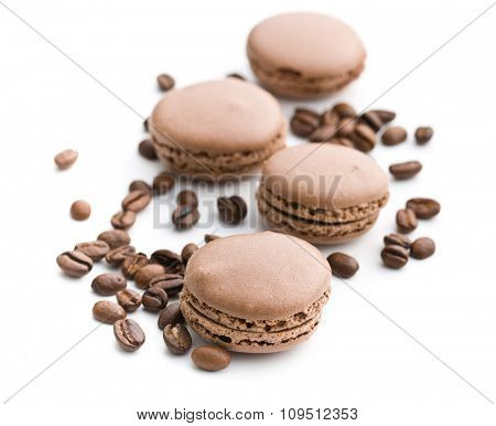 macarons with coffee flavor and coffee beans on white background