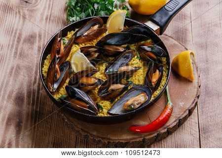 mussel paella rice in a frying pan