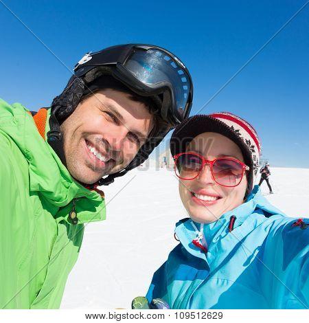 Couple skiing.