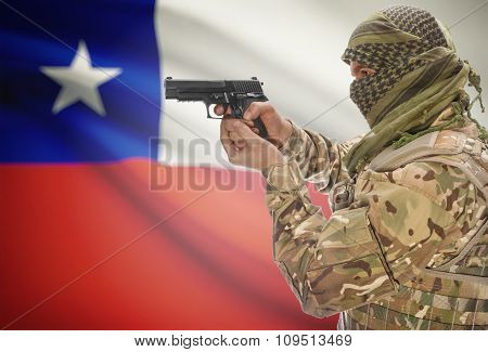 Male In Muslim Keffiyeh With Gun In Hand And National Flag On Background - Chile