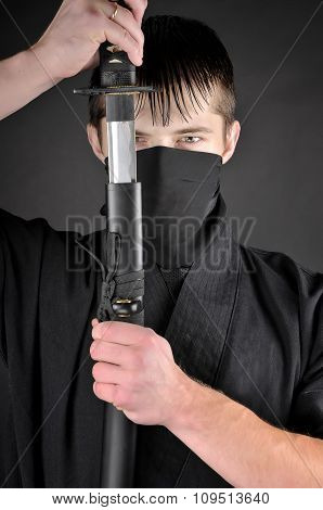 Ninja - Spy, Saboteur, Stealth Assassin Of Feudal Japan. Close-up Portrait Of Ninja With Sword.