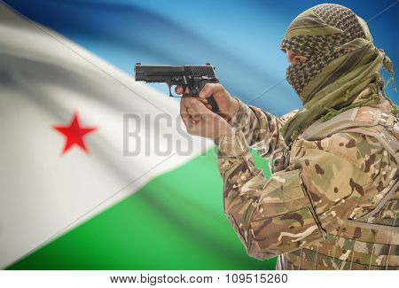 Male In Muslim Keffiyeh With Gun In Hand And National Flag On Background - Djibouti
