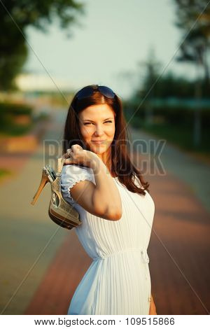 Brunette Woman Holding A High Heeled Shoes