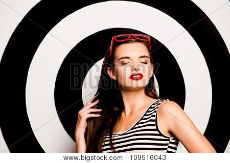 Glamorous Cute Young Woman With Glasses On Her Head  Against The Background Of Circles