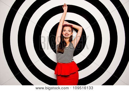 Glamorous Cheerful Young Woman With Glasses On Her Head  Against The Background Of Circles