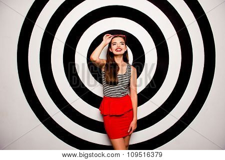 Glamorous Cheerful Young Woman Holding Glasses Against The Background Of Circles