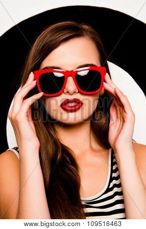 Glamorous Sexy Girl Holding Glasses Against The Background Of Circles