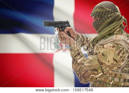 Male In Muslim Keffiyeh With Gun In Hand And National Flag On Background - Dominican Republic