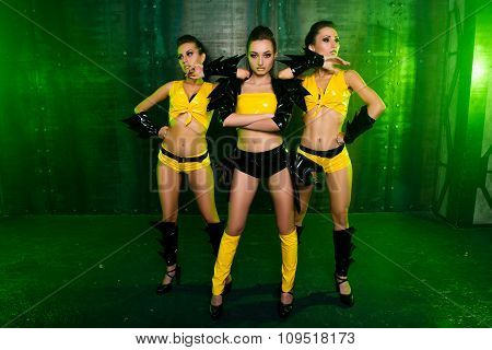 Three Sexy Cute Girls In Stage Costumes