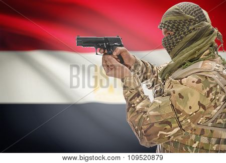 Male In Muslim Keffiyeh With Gun In Hand And National Flag On Background - Egypt