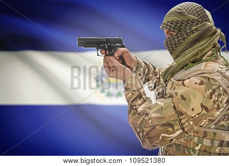 Male In Muslim Keffiyeh With Gun In Hand And National Flag On Background - El Salvador