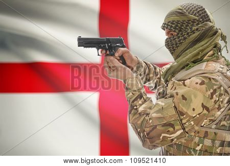 Male In Muslim Keffiyeh With Gun In Hand And National Flag On Background - England