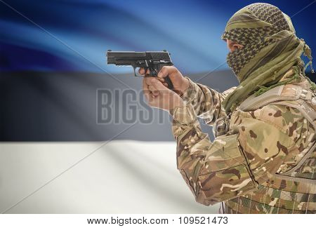 Male In Muslim Keffiyeh With Gun In Hand And National Flag On Background - Estonia