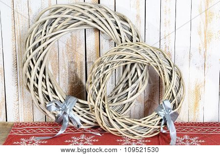 Two Christmas Wreaths Decoration On A Wooden Background