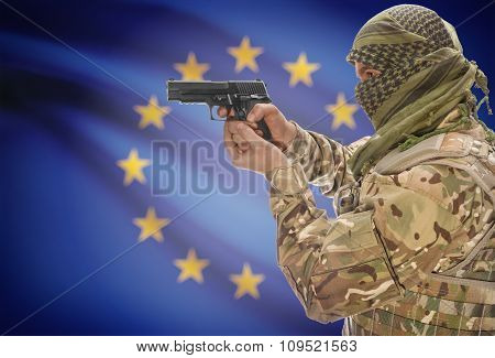 Male In Muslim Keffiyeh With Gun In Hand And National Flag On Background - European Union
