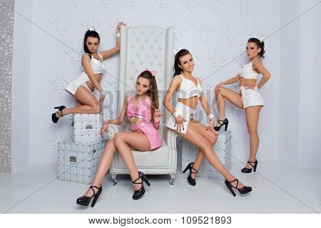 Intriguing Sexy Girls Sitting On A Chair