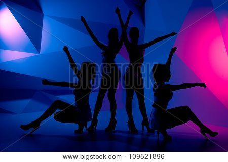 Silhouettes Of Four Sexy Posturing Girls