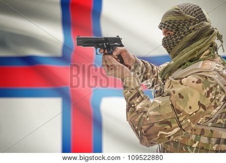 Male In Muslim Keffiyeh With Gun In Hand And National Flag On Background - Faroe Islands