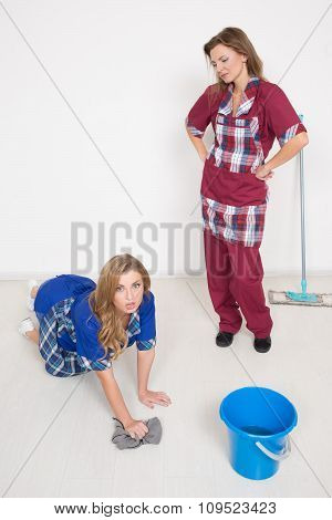 two different cleaners compete. poor staff. wash the floor, clean office