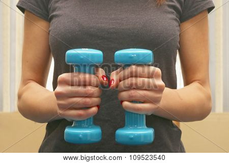 woman with dumbbells bodybuilding