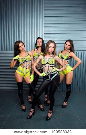 Four Confident Sexy Girls In Stage Costumes