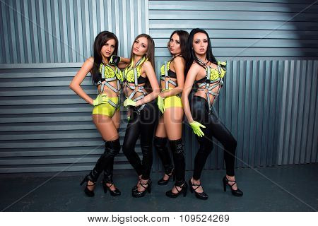 Four Alluring Sexy Pretty Girls In Stage Costumes
