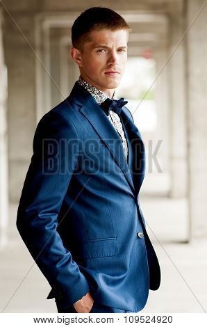 man in blue suit with bow tie