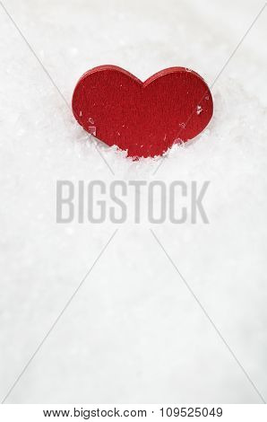 Red Heart Upright In White Snow