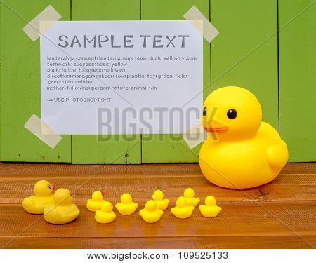 lecture or conference concept, Big yellow duck standing inf front of smaller ducks to explain detail