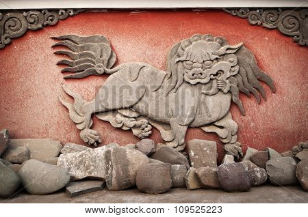 Details of ancient carved animal at monastery, Leh city, India.