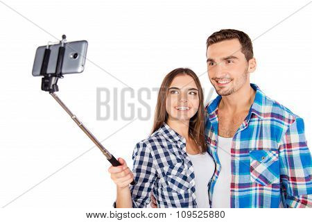 Cheerful Couple In Love Making Selfie Photo With Selfie Stick
