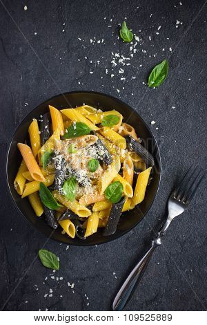 Colorful Penne Pasta  With Parmesan Cheese And Basil