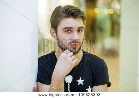 Close up portrait of an attractive young guy, indoor