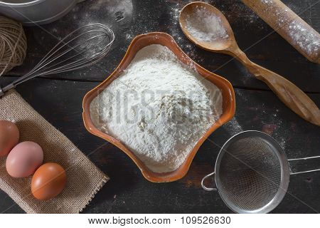 Old kitchen table with products and utensils