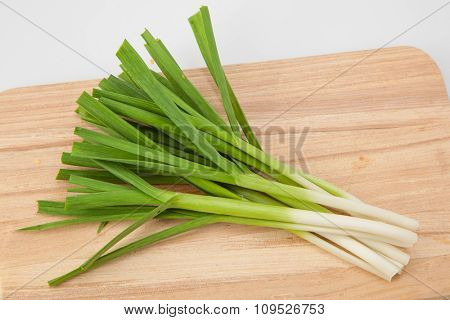 young green garlic on a cutting board. close-up