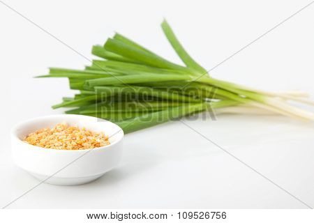 young green garlic with the dry granules. close-up
