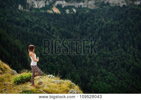 Woman Yoga Relax At The End Of Earth In Fascinating Landscape