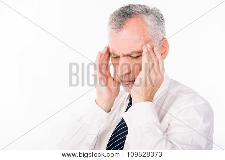 Old Man Suffering Of Headache In Business Suit