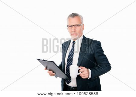 Old Confident Businessman With Glasses Holding A Folder And A Cup