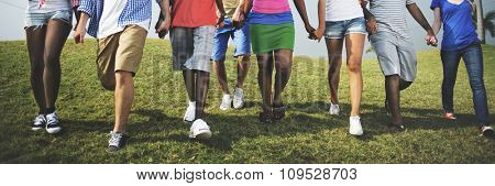 Group Casual People Walking Together Outdoors Concept