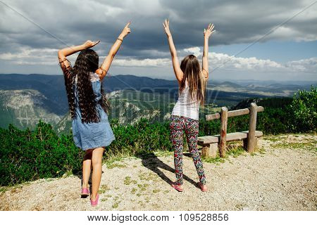 Two Girls Happy Dance On Peal Of Mountains