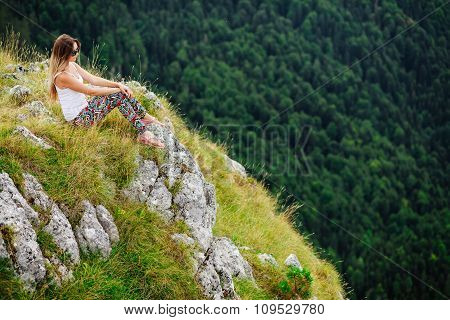 Woman Sitting  At The End Of Earth In Fascinating Landscape